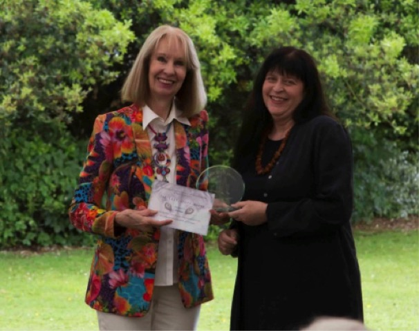 Ros receives her award from Pollyanna Pickering